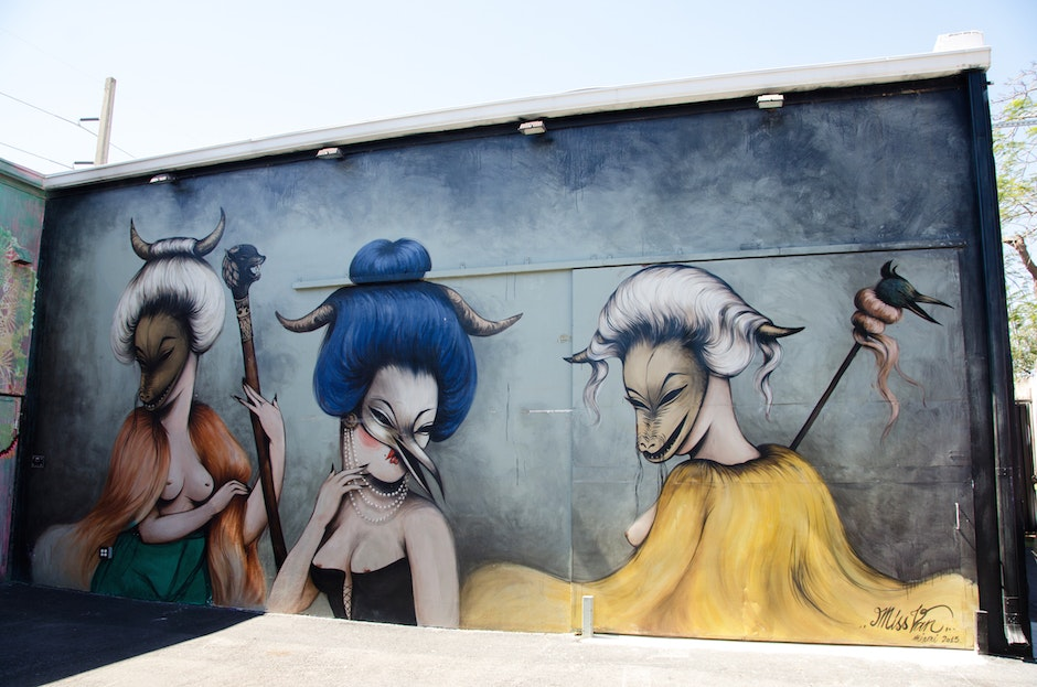 Masquerade Wynwood wall by Miss Van