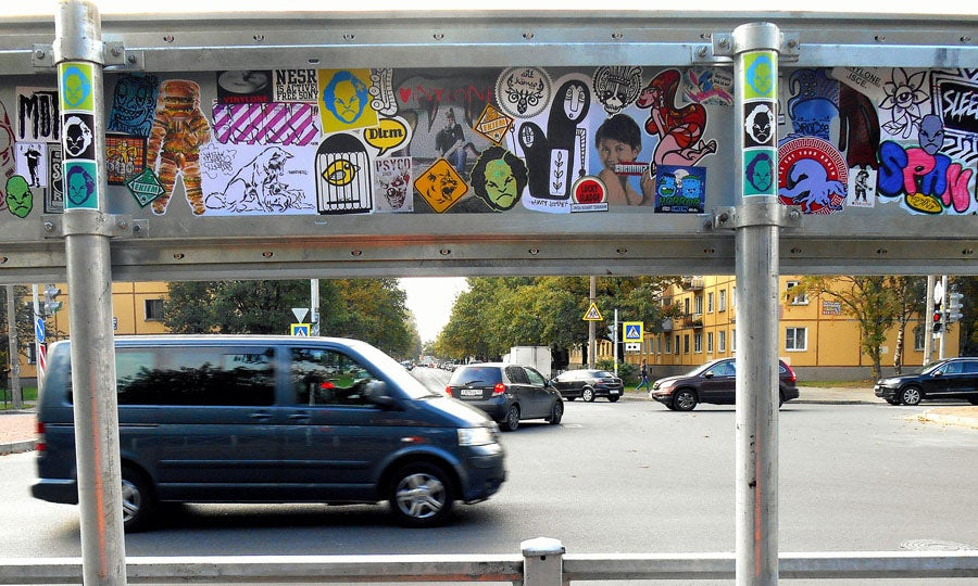 Sticker art on a street sign