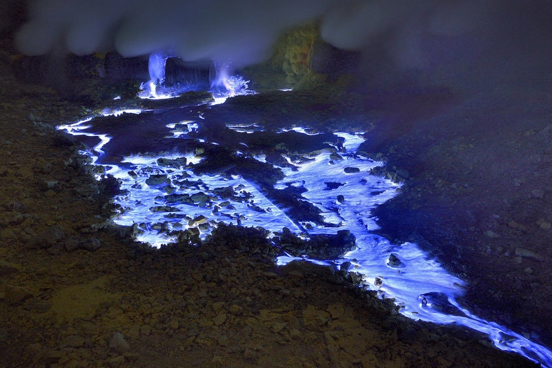 Escaped at gaseous state from the Kawah Ijen crater on Java Island in Indonesia sulfur combusts on contact with air, liquefies and run in impressive rivers of blue flames. Indonésia