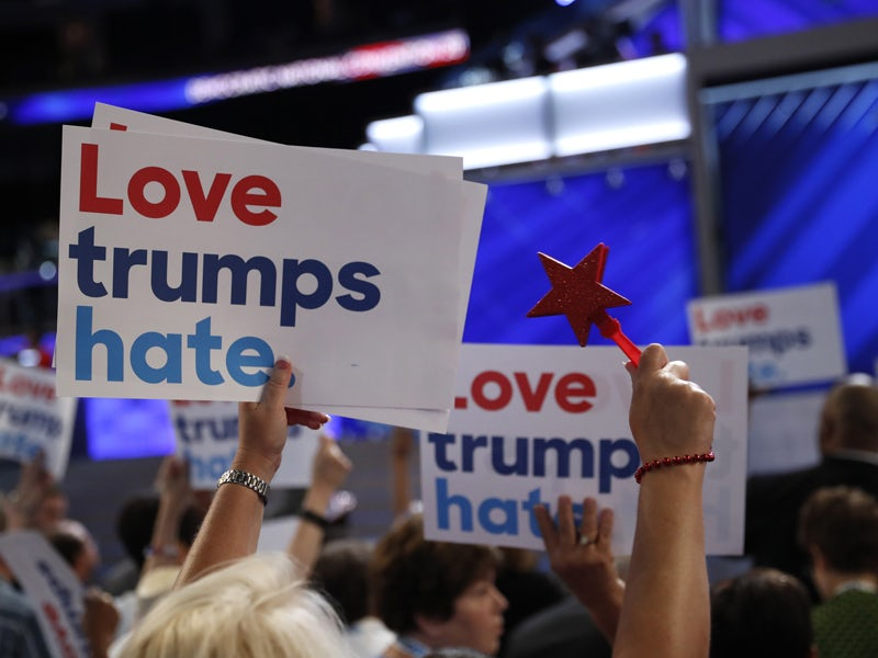 "Delegates wave ""Love trumps hate"" signs towards the podium during the first session at the Democratic National Convention in Philadelphia, Pennsylvania, U.S. July 25, 2016. REUTERS/Mark Kauzlarich - RTSJLN8"