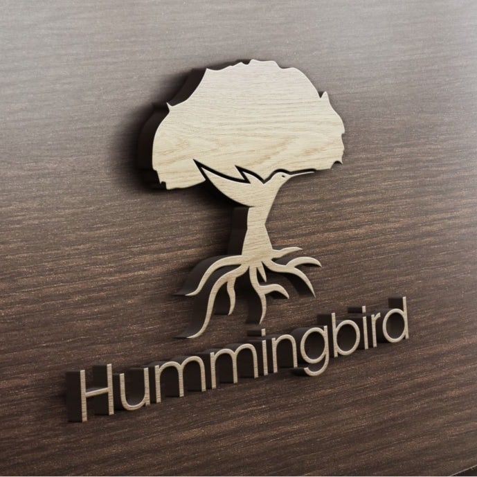 creative logo design of tree with trunk shaped like hummingbird