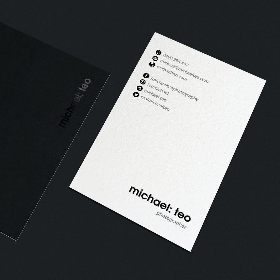 A black and white business card
