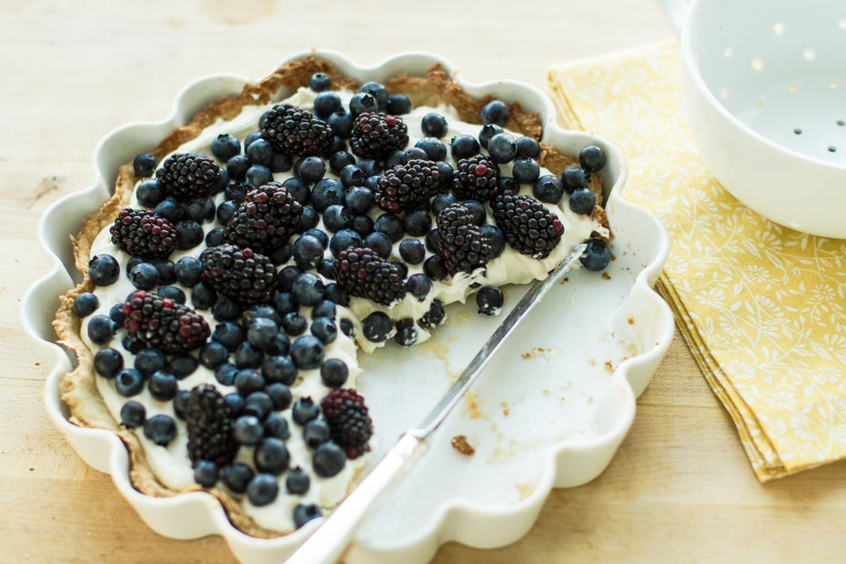 Blueberry and blackberry pie with a piece missing