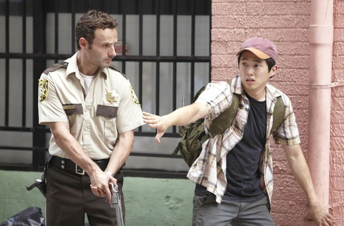 Andrew Lincoln as Rick Grimes and Steven Yeun as Glenn