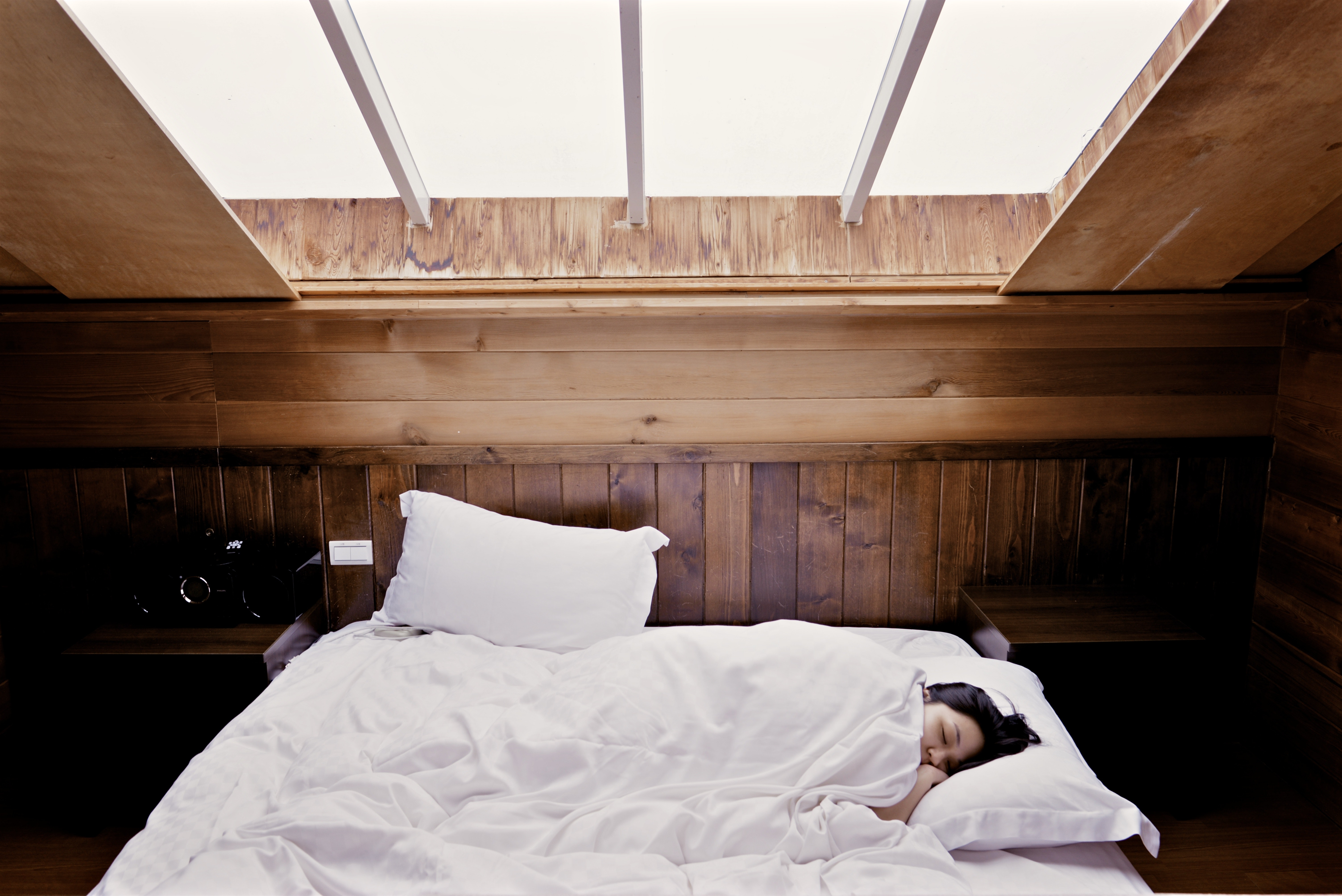 Woman lying in bed during daylight