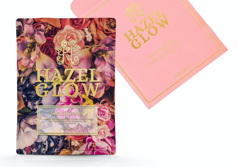 warm toned floral mask packaging with gold font