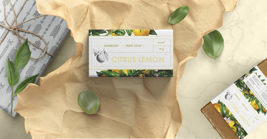 soap packaging with realistic drawings of lemons and leaves