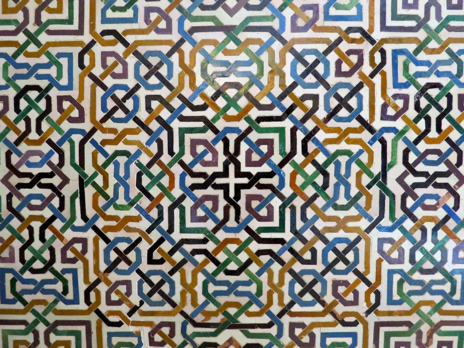geometric pattern on tiles in the Alhambra, Spain