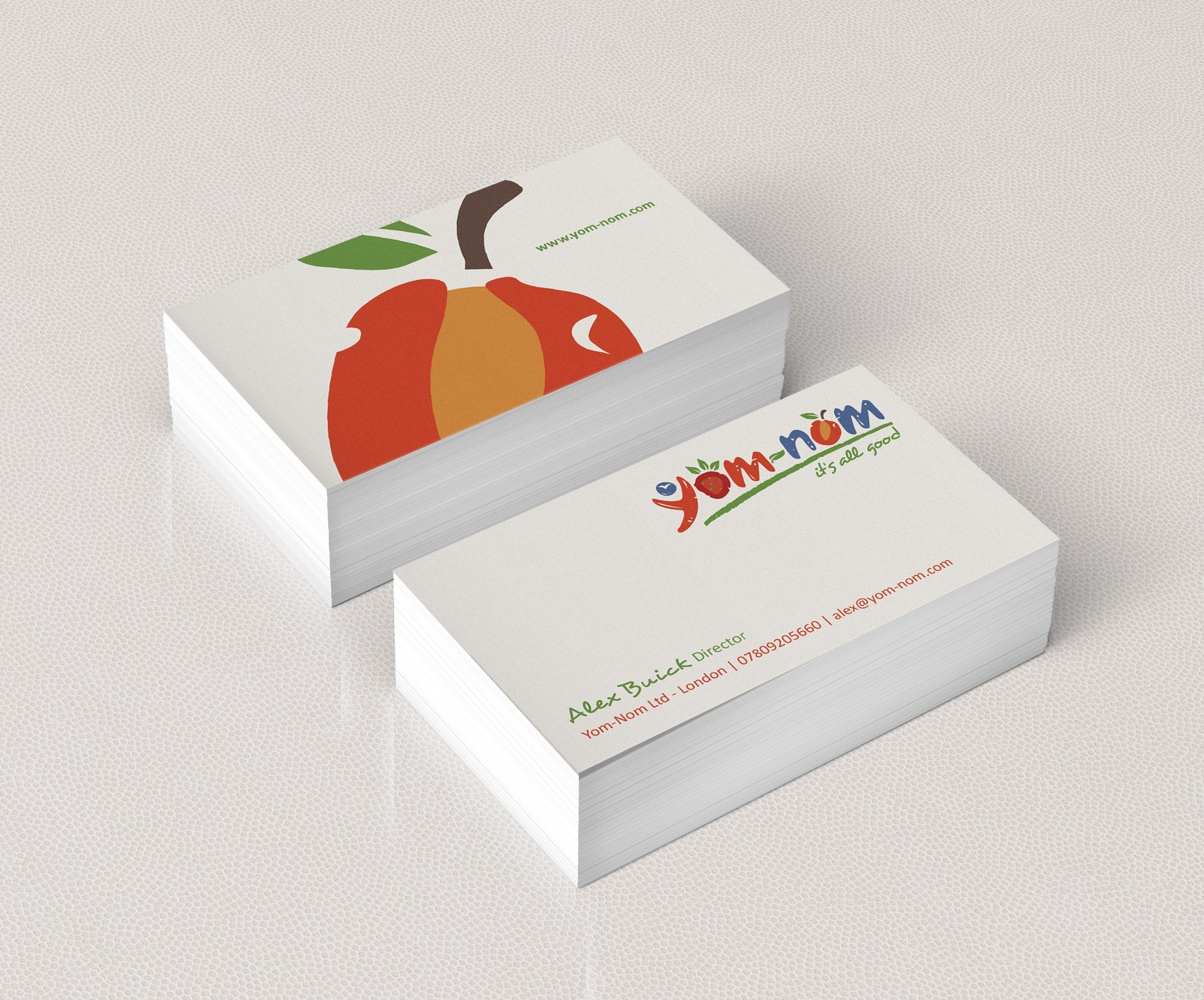 white business card with red apple
