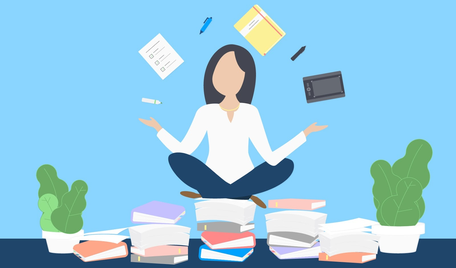 woman balancing office supplies