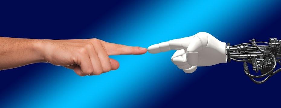Human hand touching robot hand