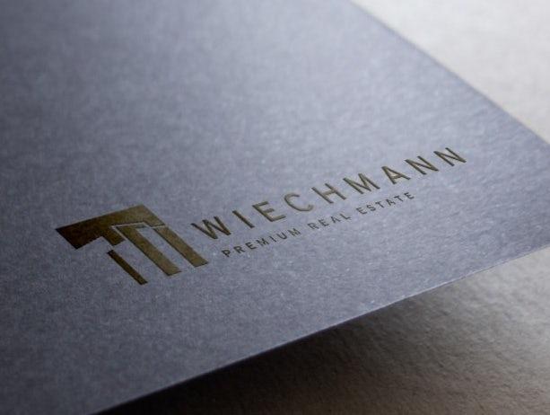 Wlechmann Real Estate business card