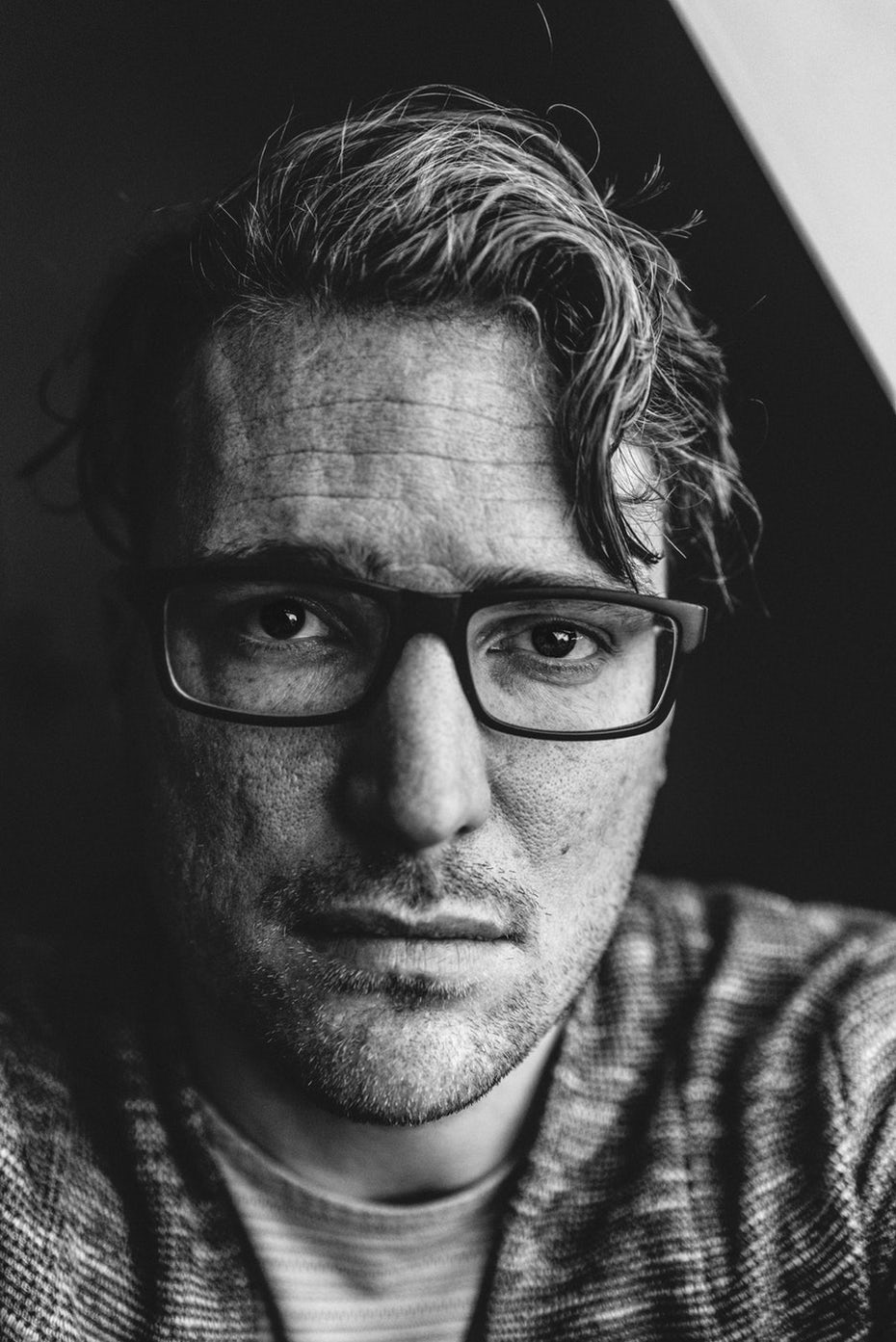Headshot of man with glasses
