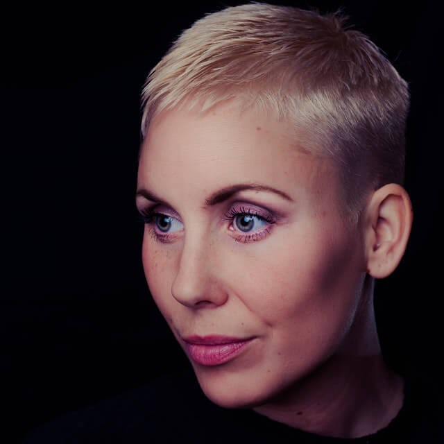 Headshot of woman with short blonde hair
