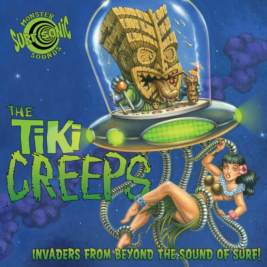 A tiki head in a flying saucer, holding onto a woman with its metal octopus tentacles