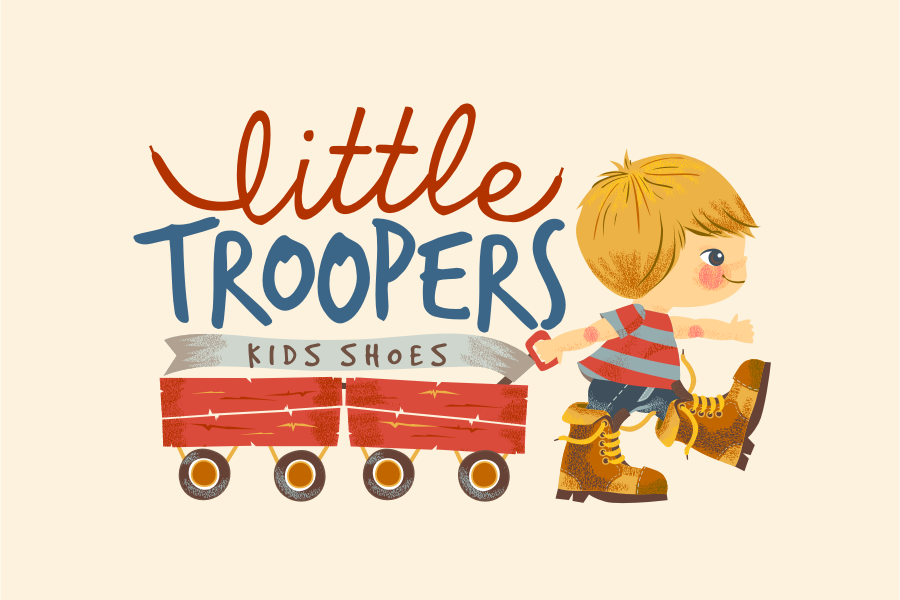 """Little boy in boots pulling two wagons with the text """"Little Troopers kids shoes"""""""