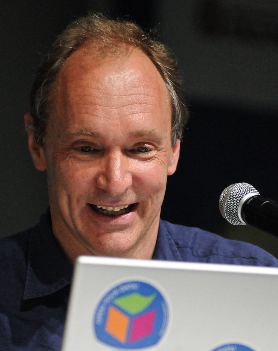 Tim Berners-Lee looking excitedly at a computer screen