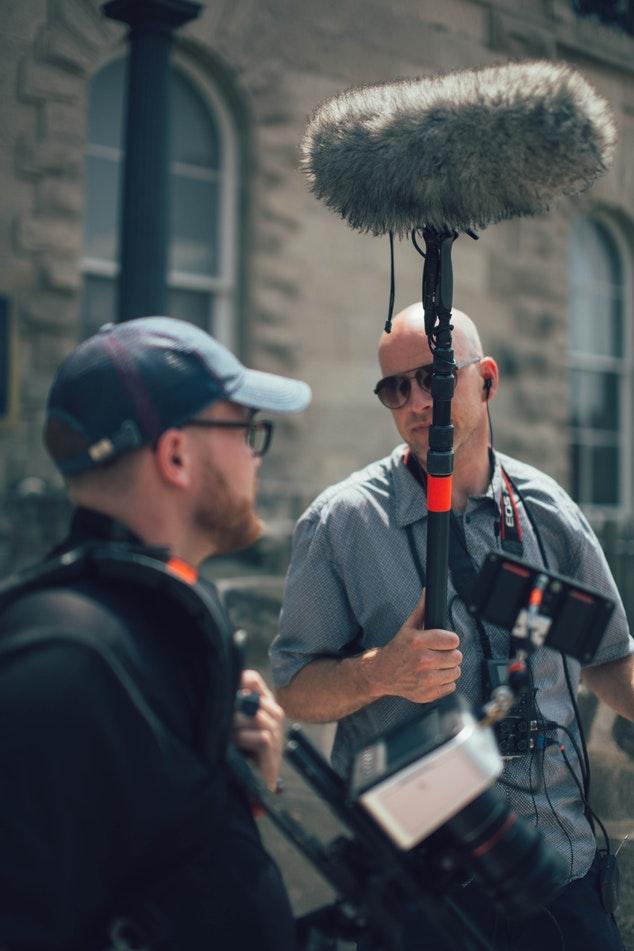 Sound recordist and camera operator discuss the next shot