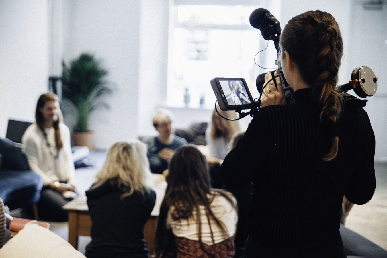 Videographer films a productive meeting