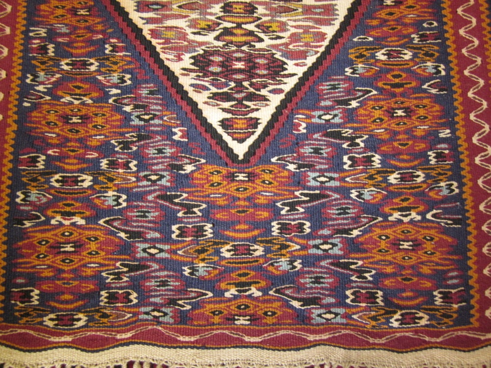 An antique rug with a geometric pattern