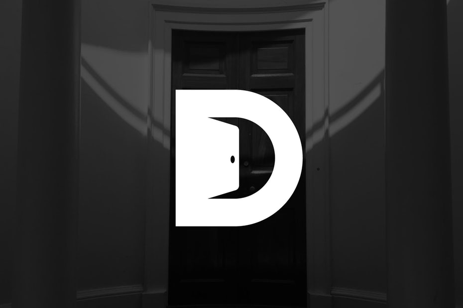 Capital D with a door opening in its negative space