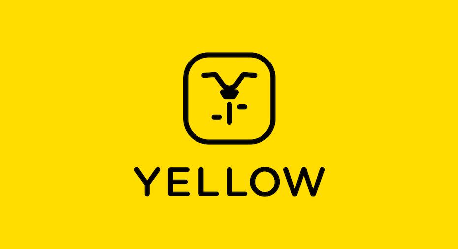 Icône jaune avec une image noire minimaliste d'un vélo