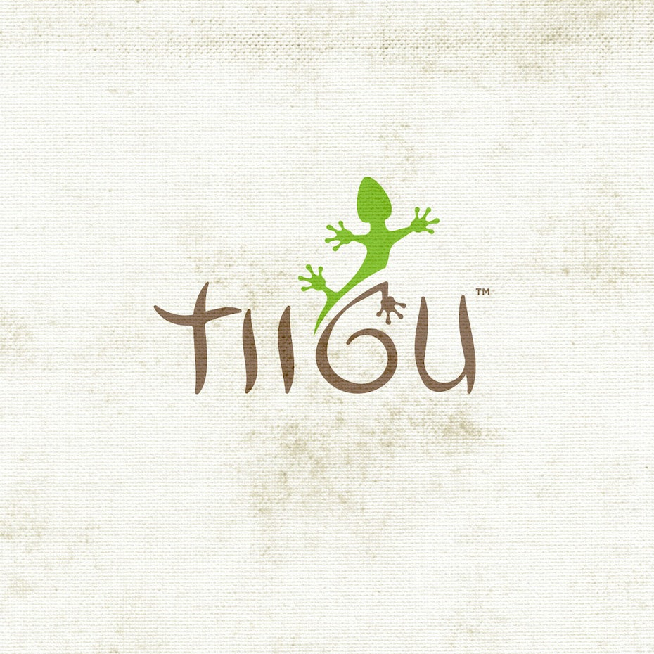 "minimalist wordmark logo that says ""TIIGU"" with a lizard crawling above the G"