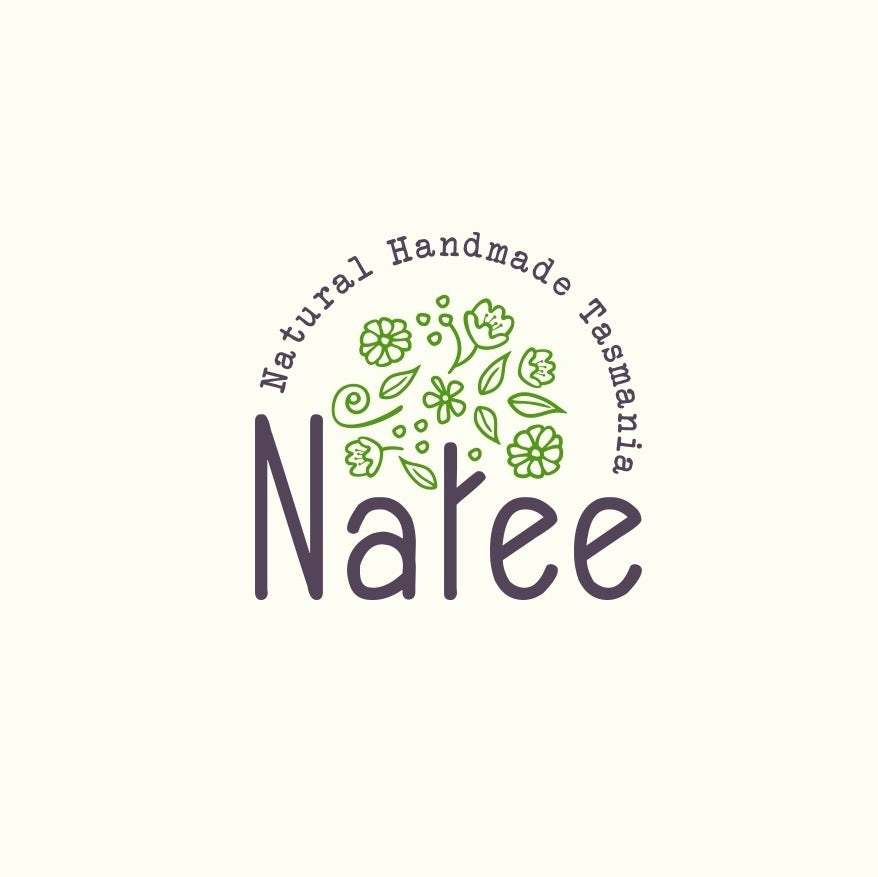 "round logo with the letter ""t"" in ""Natee"" illustrated as a tree trunk with green leaves and flowers floating above it"