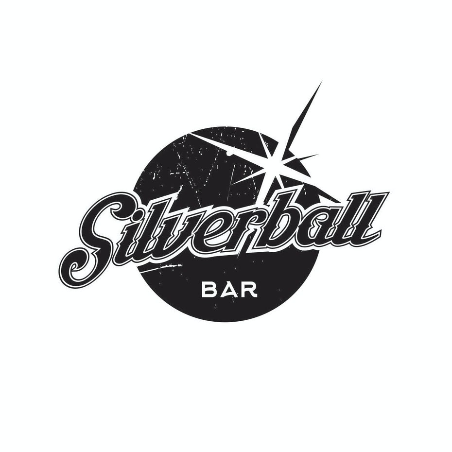 round distressed logo with the wordmark across a depiction of a pinball