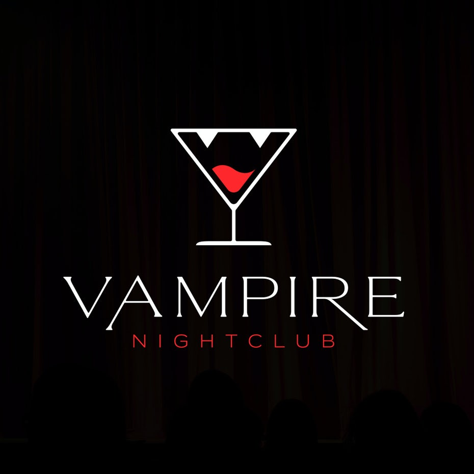 white outline of a martini glass with two triangles at the top to represent fangs and red liquid inside like a tongue