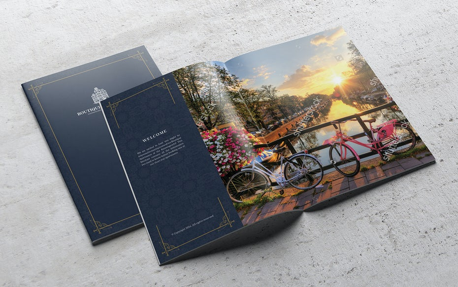 Mockups for a dark blue booklet