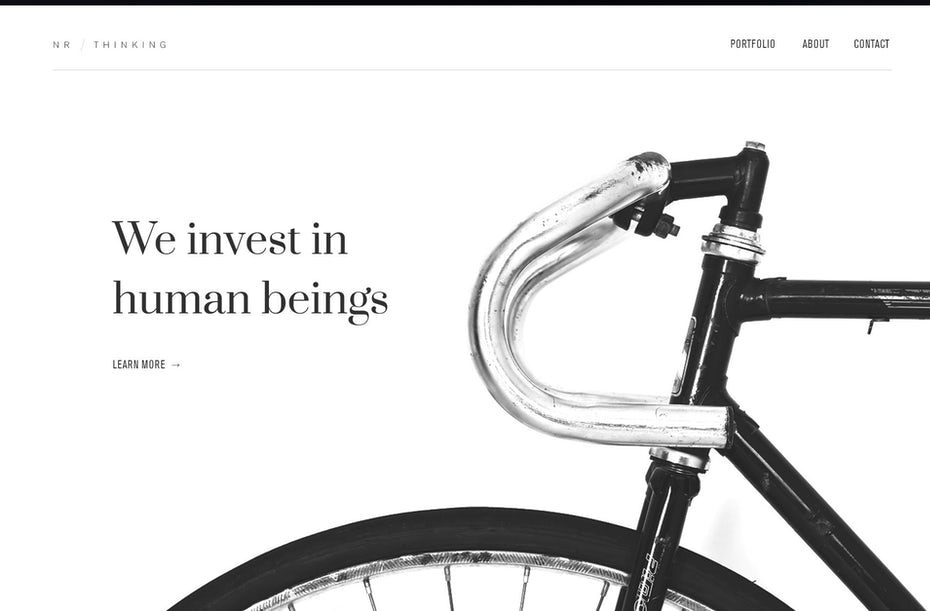 minimalist monochrome web design with large photo of bicycle