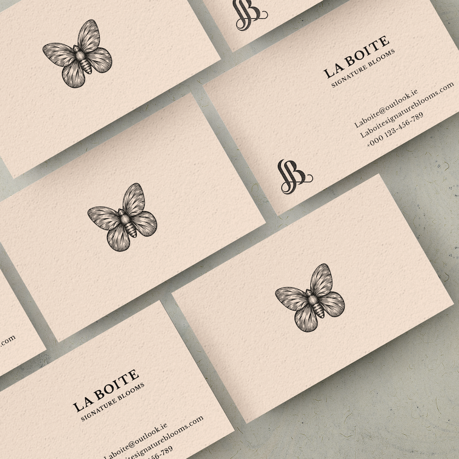 Business cards trends 2020 example: Butterfly drawing business card