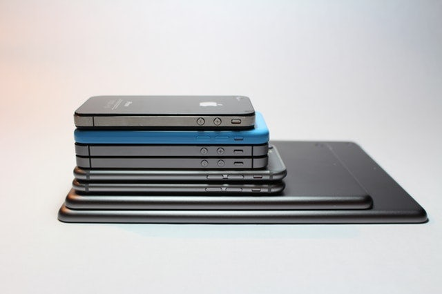 stack of smart phones and tablets