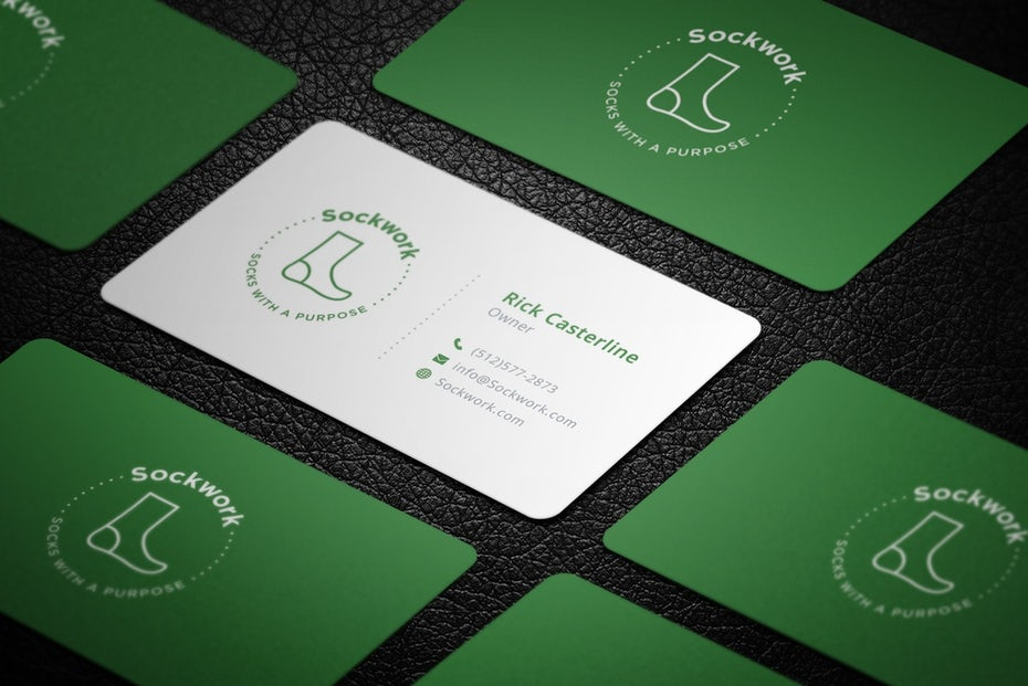 Green and white business cards with images of socks on them