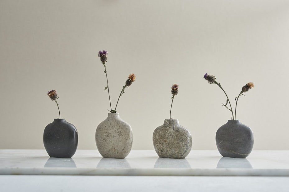 Photo of ceramic vases with flowers