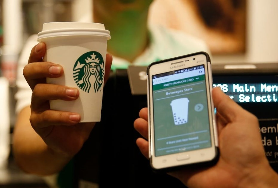 starbucks mobile app next to cup