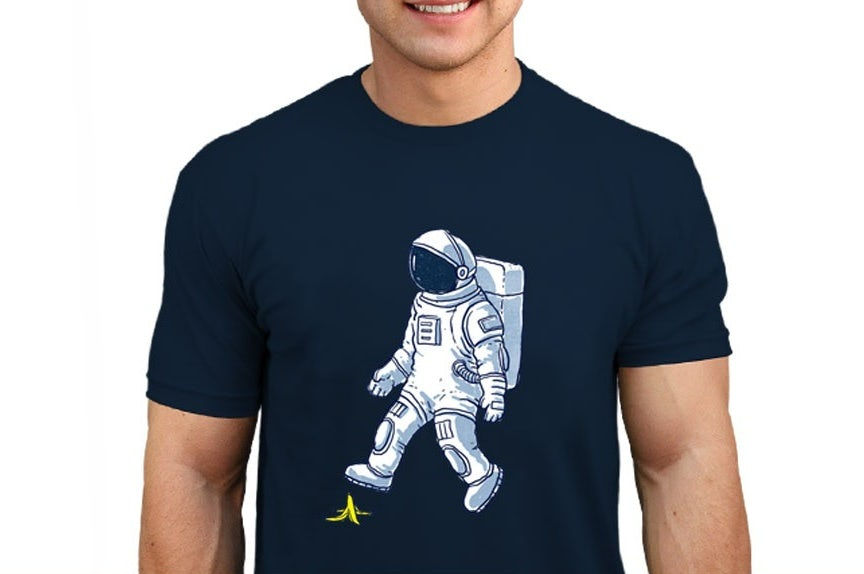 Custom t-shirt design with astronaut slipping on banana peel