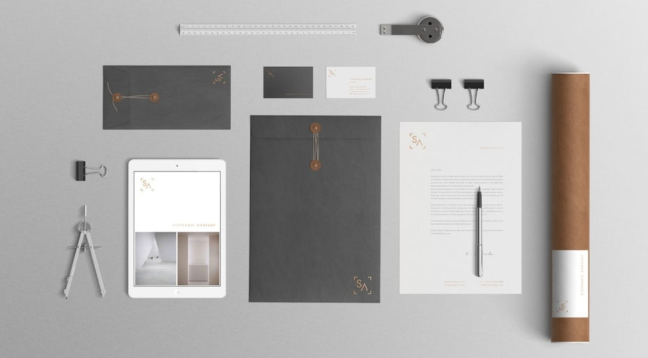 Collection of envelopes, tools, stationary and business cards showing an architecture firm's branding