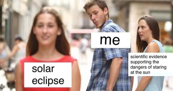 Distracted boyfriend meme about looking at the solar eclipse