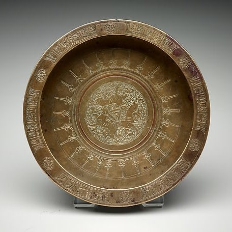 Copper tray showing the three hares symbol