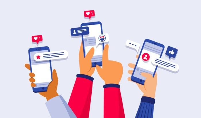 Illustration dreier smartphones mit social media auf dem display