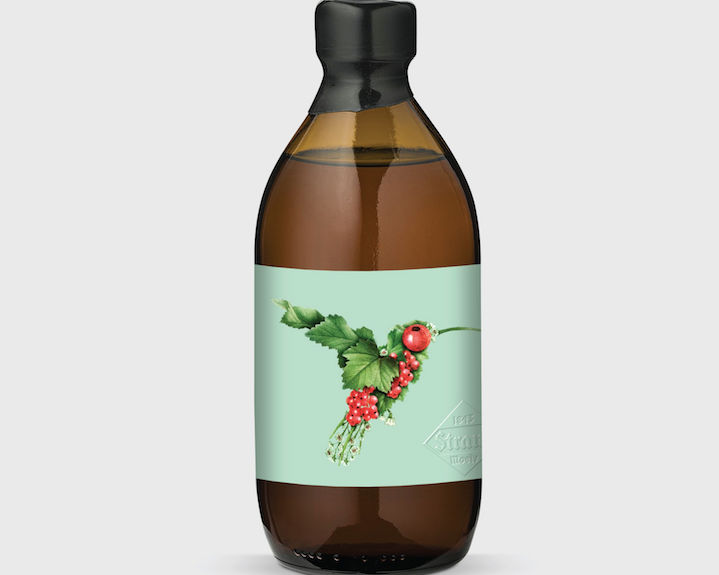 bottle label showing a hummingbird collage design created with smaller images of leaves and berries