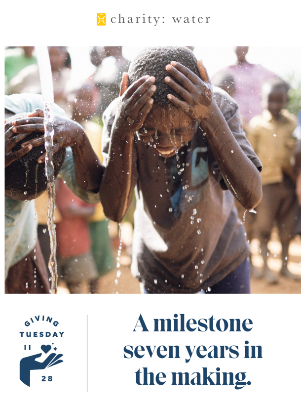 giving day newsletter featuring happy boys under pouring water
