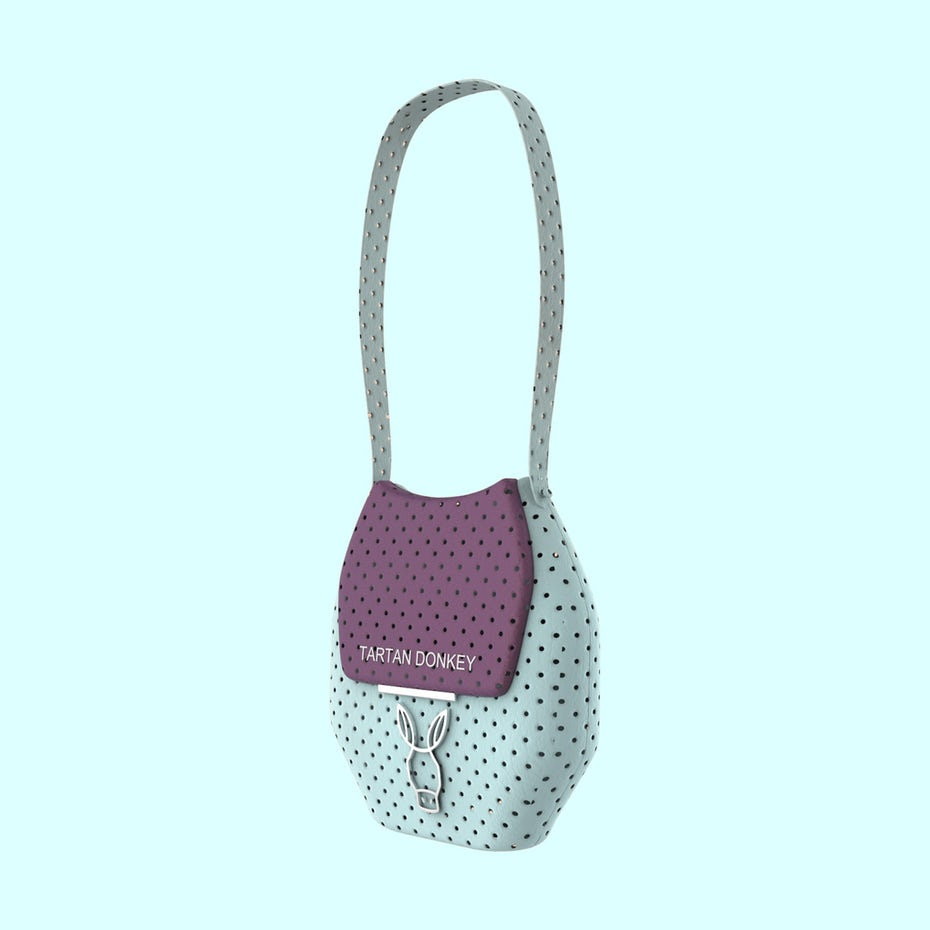merchandise branding with light blue and purple handbag with a pattern of holes