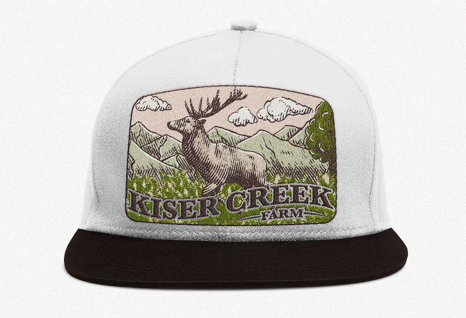 merchandise branding with baseball cap with a patch showing an elk