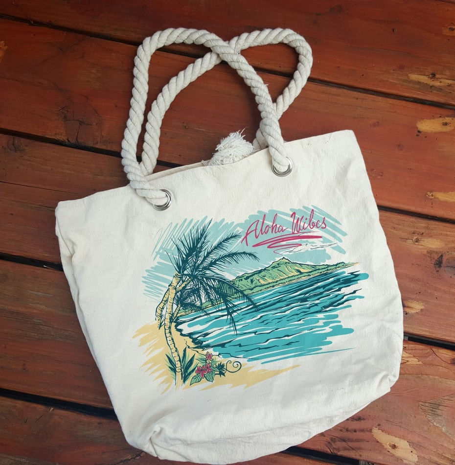 merchandise branding with tote bag with rope handles and a tropical scene design
