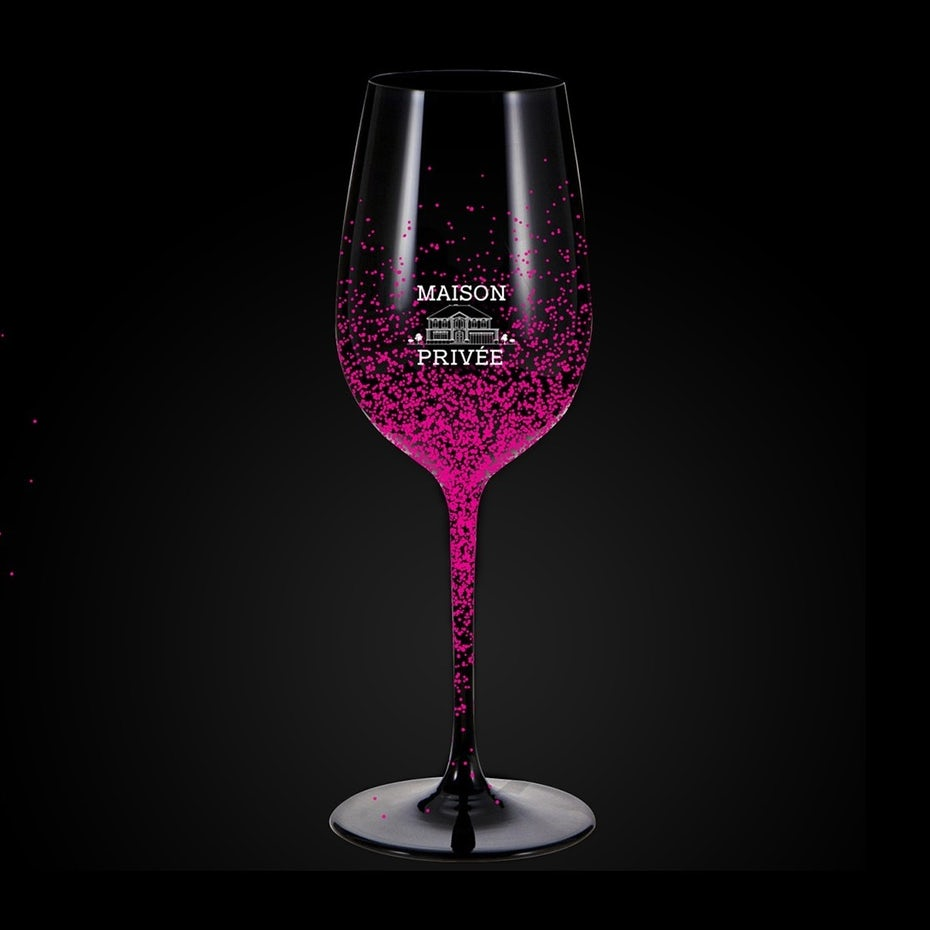 merchandise branding with wine glass design with pink flecks on it