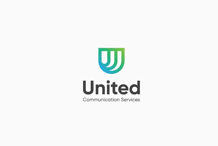 geometric badge-shape logo with green and blue gradient