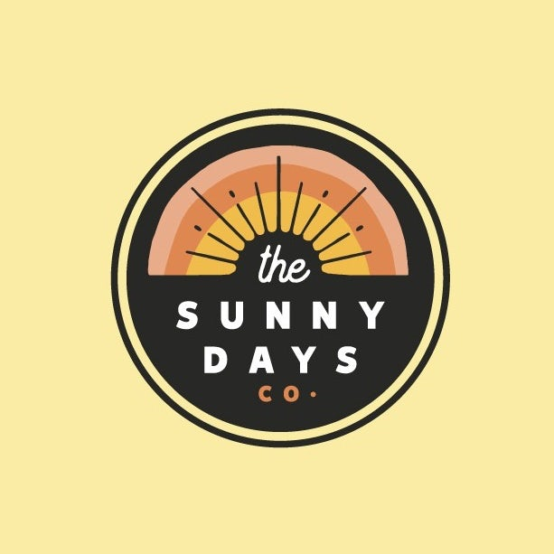 yellow, orange and peach logo showing a sunrise with negative space sunbeams